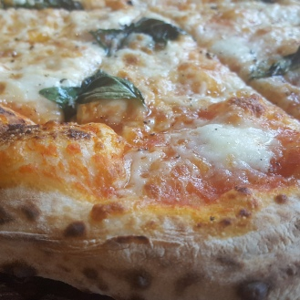 The quintessential Margherita. Notice how well the Cornicione has been done.